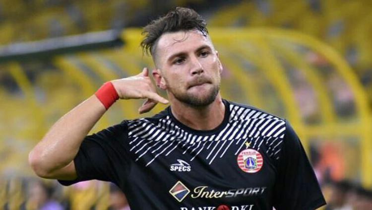 Marko Simic melakukan selebrasi usai mencetak gol pertama. Copyright: Media Persija