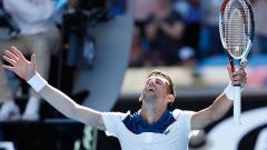 Indosport - Novak Djokovic saat berlaga di ajang Australia Terbuka 2018.