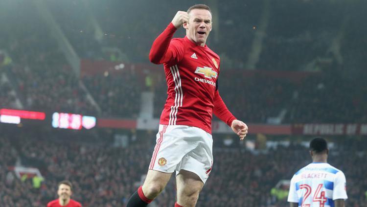 Wayne Rooney selebrasi saat bersama Man United. Copyright: Getty Images