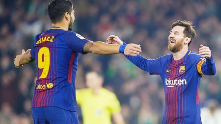 Luis Suarez (kiri) dan Lionel Messi (kanan). - INDOSPORT