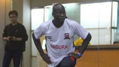 Indosport - Pemain bertahan anyar Madura Unted, OK John.