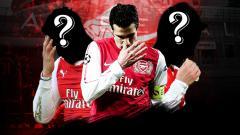 Indosport - Mantan pemain Arsenal tertunduk lesu.