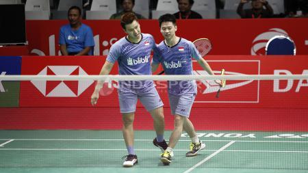 Kegembiraan Kevin Sanjaya/Marcus Fernaldi usai mengalahkan senior mereka, Hendra Setiawan/Rian Agung Saputro. - INDOSPORT