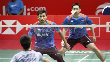 Pebulutangkis ganda putra Hendra Setiawan mengakui keahlian juniornya yakni Kevin Sanjaya yang disebutnya merupakan salah satu pemain depan tercepat saat ini. - INDOSPORT