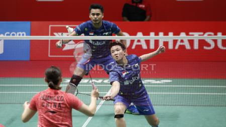 Ganda campura Indonesia, Tontowi Ahmad dan Liliyana Natsir melawan Zhing Siwei dan Huang. - INDOSPORT
