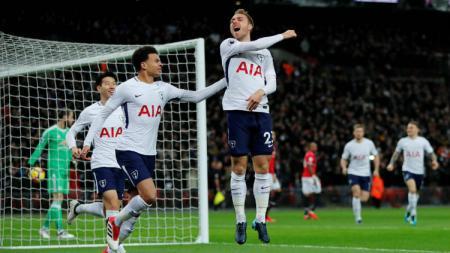 Christian Eriksen saat merayakan gol ke gawang Manchester United. - INDOSPORT
