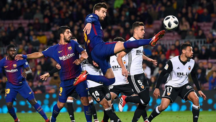 Gerard Pique saat tampil membela Barcelona di semifinal Copa del Rey. Copyright: INDOSPORT