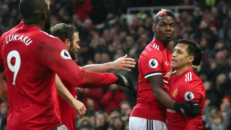 Skuat Manchester United saat merayakan gol ke gawang Huddersfield Town. Copyright: INDOSPORT