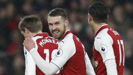 Gelandang Arsenal Aaron Ramsey saat merayakan gol ke gawang Everton. - INDOSPORT