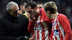 Indosport - Gigi Diego Godin tampak berdarah setelah berbenturan dengan kiper Sevilla.