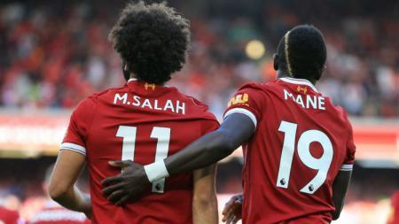 Salah dan Mane saat merayakan gol Liverpool. - INDOSPORT