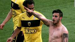 Indosport - Giorgos Katidis melakukan selebrasi salut Nazi