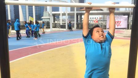 Heri, salah satu anak yayasan SAJA yang mengikuti acara buatan Workout Embassy.