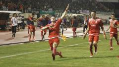 Indosport - Marko Simic melakukan selebrasi.