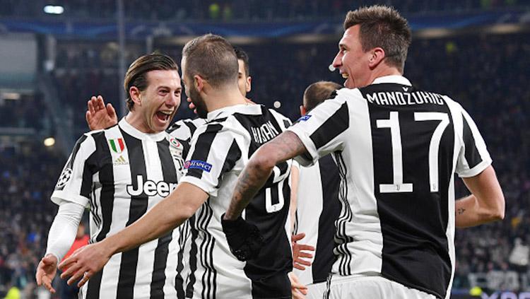Aksi selebrasi para pemain Juventus pada laga saat melawan Tottenham Hotspur. Copyright: INDOSPORT