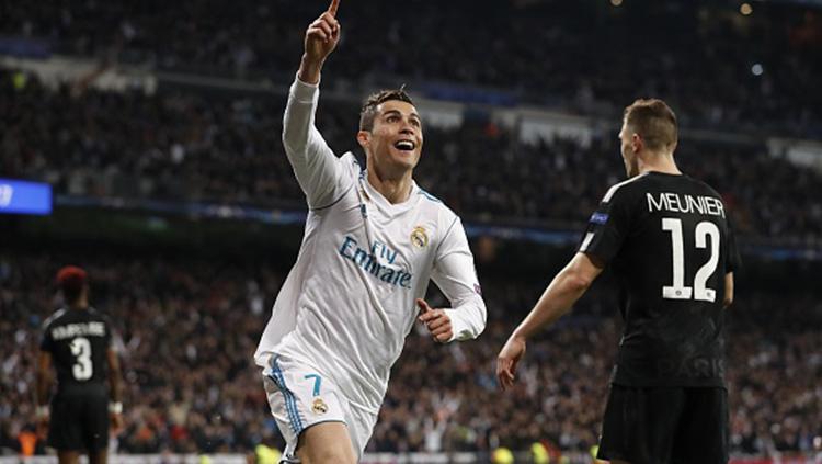 Cristiano Ronaldo tampak frutrasi setelah selalu gagal mencetak gol melawan PSG di babak 16 besar Liga Champions. Copyright: INDOSPORT