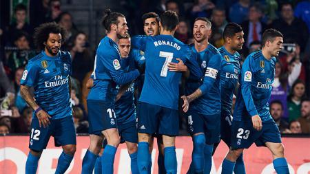 Real Madrid merayakan gol. - INDOSPORT
