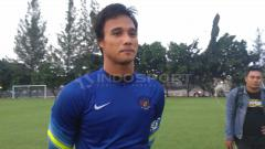 Indosport - Kiper Timnas Indonesia dan Madura United, Muhammad Ridho.