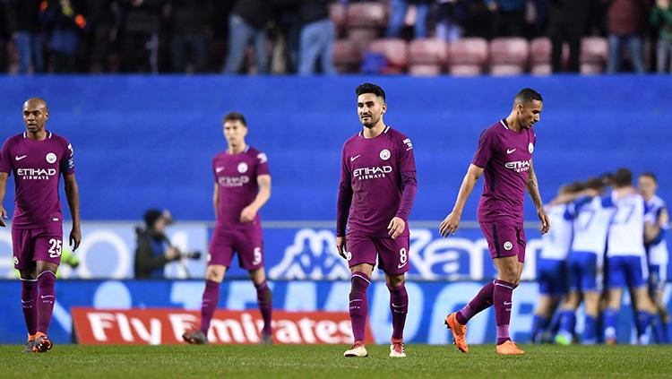 Manchester City takluk dari Wigan Athletic. Copyright: INDOSPORT