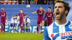 Indosport - William Grigg berhasil membawa timnya unggul atas Manchester City dengan skor 1-0 tanpa balas.