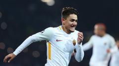 Indosport - Cengiz Under saat melakukan selebrasi untuk AS Roma.