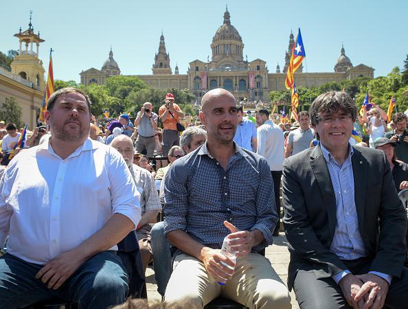 Oriol Junquera, Pep Guardiolam dan Carles Puigdemont Copyright: Getty Image