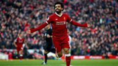 Indosport - Selebrasi Mohamed Salah seteah membobol gawang West Ham United.