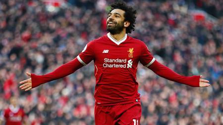 Mohamed Salah melakukan selebrasi usai cetak gol pada menit-51'. - INDOSPORT