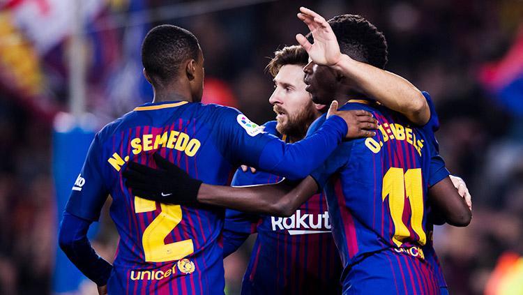 Pemain Barcelona merayakan gol Lionel Messi. Copyright: INDOSPORT