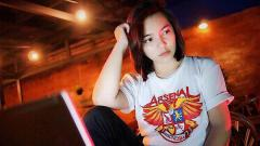 Indosport - Grace Ursula, fans Arsenal.