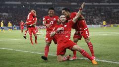 Indosport - Aksi selebrasi Marko Simic usai cetak gol ke gawang Tampines Rovers.