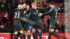 Indosport - Selebrasi pemain Manchester City usai membobol gawang Arsenal.