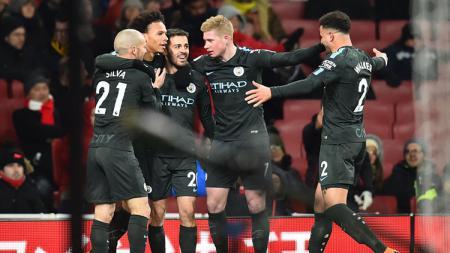 Selebrasi pemain Manchester City usai membobol gawang Arsenal. - INDOSPORT