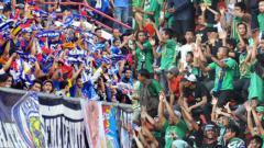 Indosport - Aremania dan Bonek.