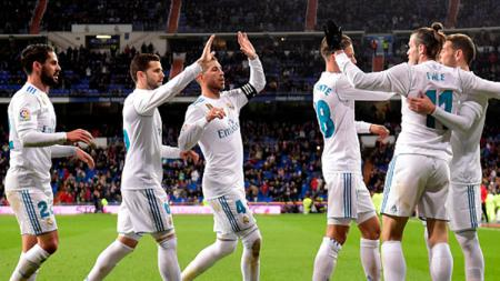 Para pemain Real Madrid melakukan selebrasi usai Bale cetak gol ke gawang Getafe. - INDOSPORT