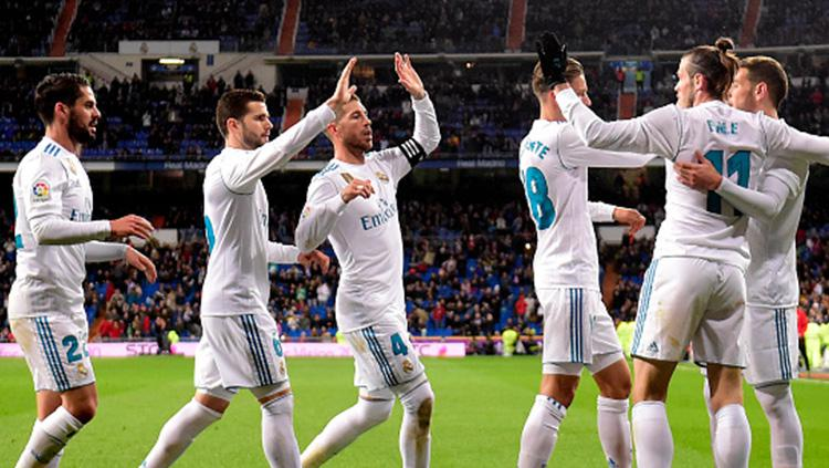 PAra pemain Real Madrid melakukan selebrasi usai Bale cetak gol. Copyright: INDOSPORT