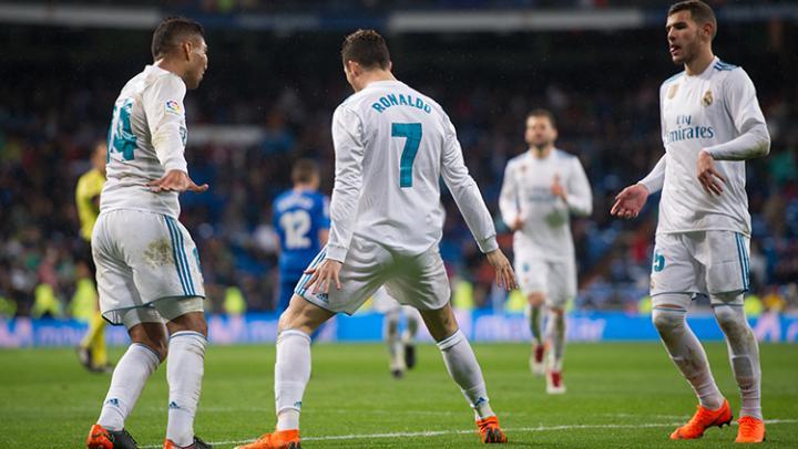 Selebrasi Cristiano Ronaldo usai mencetak gol ke gawang Getafe. Copyright: INDOSPORT