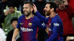 Indosport - Jordi Alba dan Lionel Messi