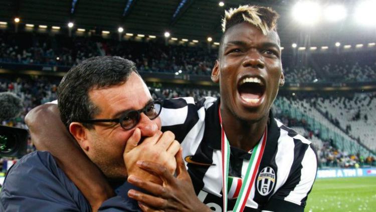 Pogba dan sang agen, Mino Raiola, saat membela Juventus. Copyright: Getty Images