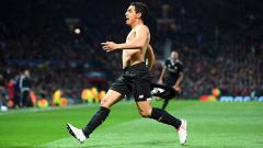 Indosport - Wissam Ben Yedder mencetak dua gol di laga 16 besar Liga Champions melaawan Man United.