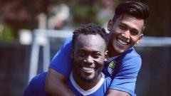 Indosport - Michael Essien dan Febri Hariyadi
