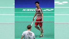 Indosport - Tampilan wajah tengil Kevin Sanjaya.