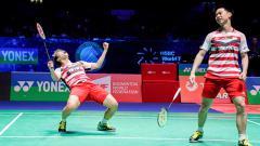 Indosport - Selebrasi Kevin/Marcus usai berhasil memenangkan laga.
