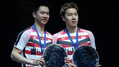 Indosport - Pasangan andalan Indonesia Kevin/Marcus saat naik di podium usai juara di All England 2018.