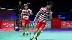 Indosport - Selebrasi Kevin/Marcus usai meraih poin di partai final All england 2018.