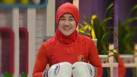 Setelah lama tak ada kabarnya, kini Monalisa Randa selaku petarung MMA berhijab Indonesia kini memutuskan untuk merangkap menjadi pelatih bela diri. - INDOSPORT