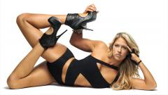 Indosport - Kelly Kelly, pegulat WWE cantik.