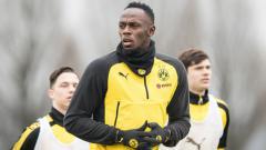 Indosport - Usain Bolt ikut latihan Borussia Dortmund.
