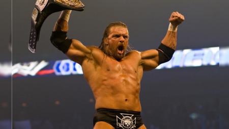 Triple H menjadi salah satu pegulat terbaik WWE yang pernah memegang sabuk juara kelas berat. - INDOSPORT