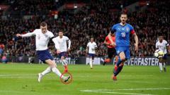 Indosport - Jamie Vardy pakai sepatu CR7
